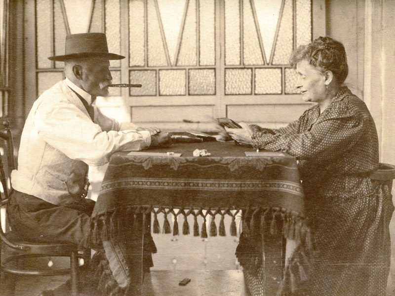 vintage man and woman smoking cigars