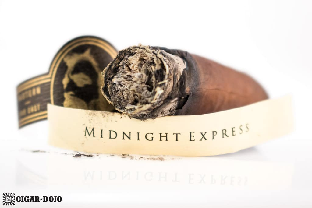 Caldwell Eastern Standard Maduro Midnight Express Jockey Club Robusto cigar nub