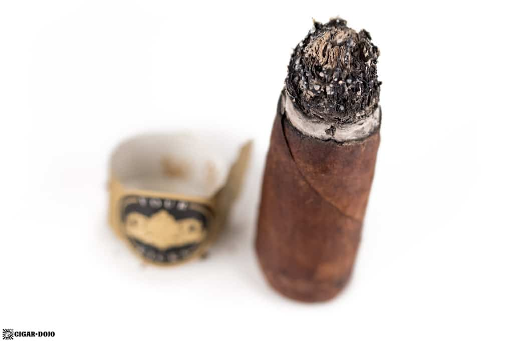Crowned Heads Four Kicks Maduro Robusto cigar nubbed