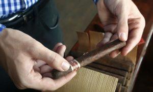 Inspecting J.C. Newman Yagua cigar